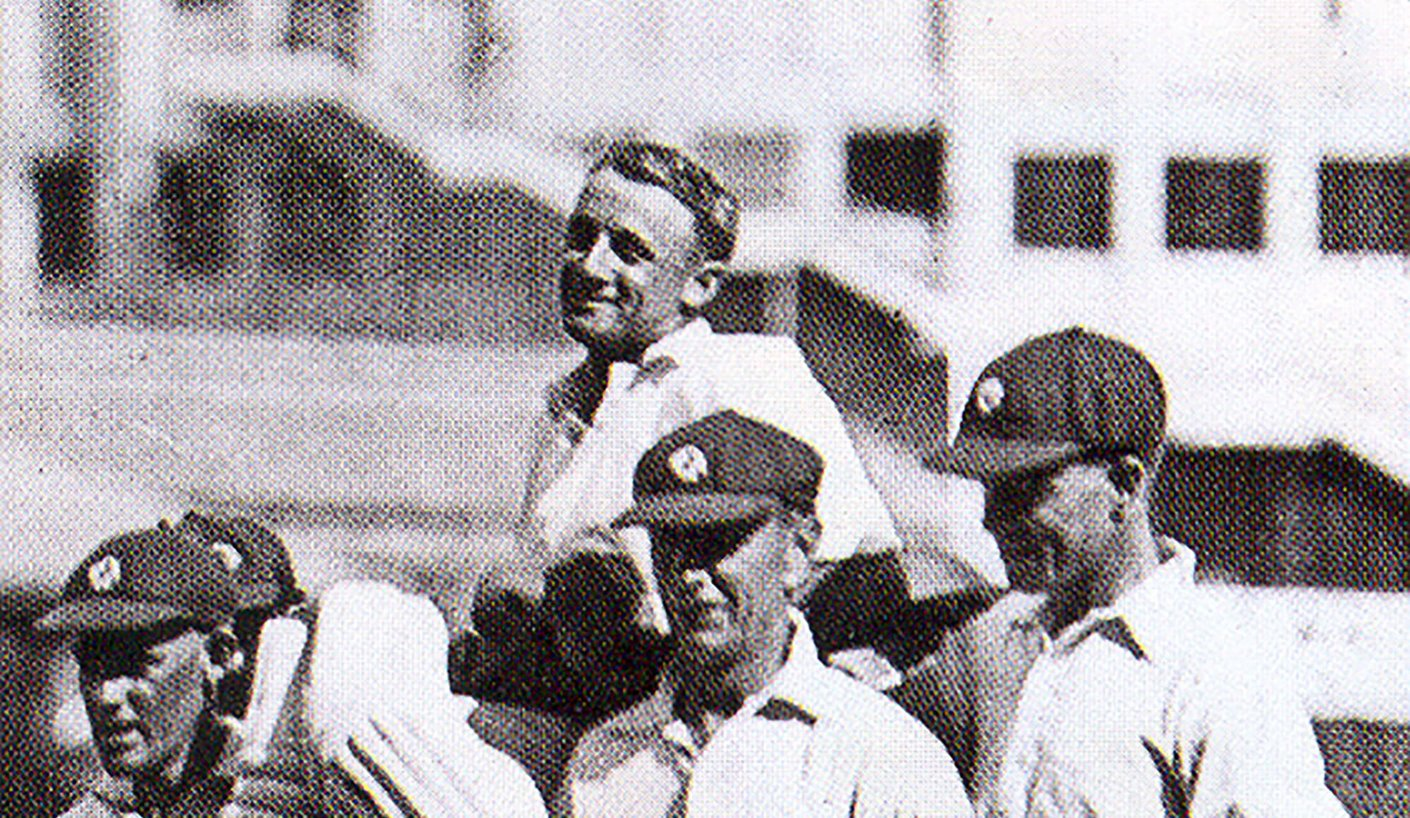 Bradman carried off by QLD fieldsmen after his record-breaking 452 not out on January 8, 1930